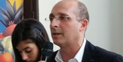 in primo piano il presidente Ersu, Alberto Firenze, durante una manifestazione a Palazzo Riso